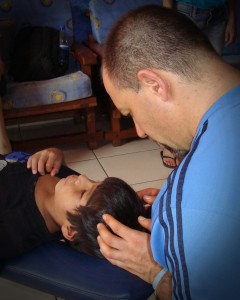 Dr. John performing CST on a recent mission trip to Bolivia